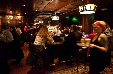 Saloon is inspired by the pre-Prohibition era. It specializes in brown liquor, with more than 100 types of whiskey. The interior has salvaged woodwork, swooping arches, and Oriental rugs. The old-school food matches the tone.
